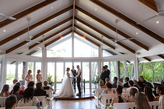 Bridae and groom exchange wedding vows, cute little wedding chapel, Palm Cove. Wedding photography by Excitations.