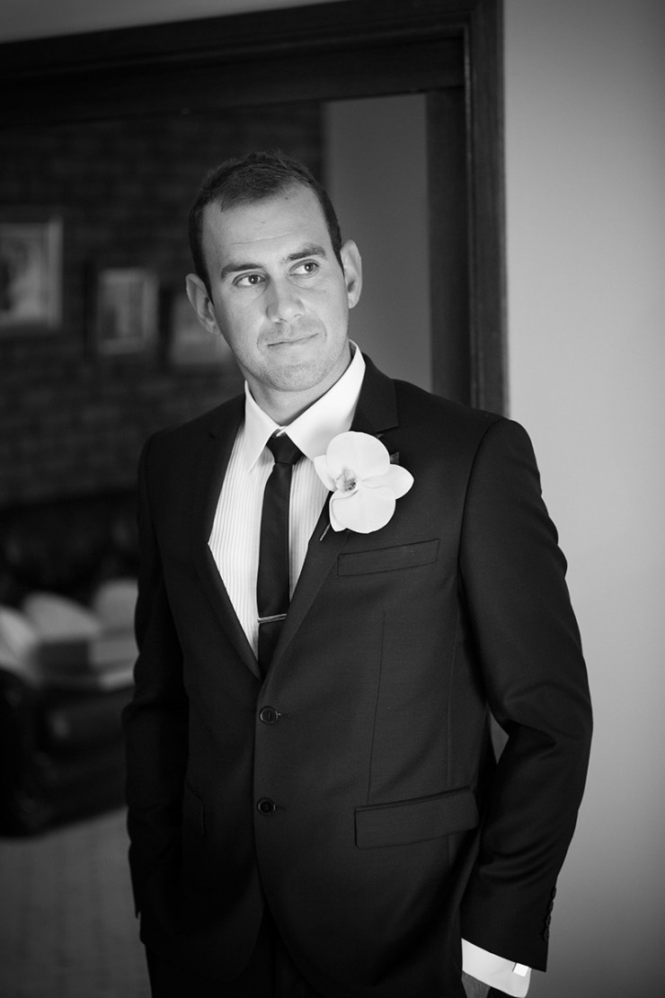 Half length black and white portrait of bride groom at home before the wedding ceremony.