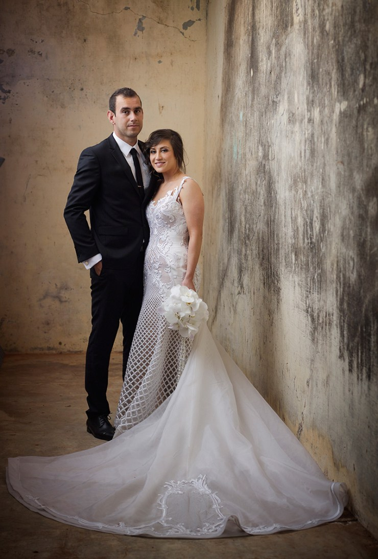 Bride and groom full length formal portrait in rustic setting. Wedding pictures by Excitations Mildura photographers.