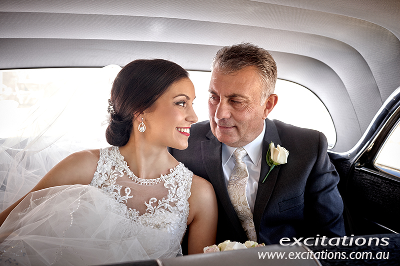 Wedding photos taken in the bridal car. Bride with dad pior to leaving for the church. Photography by excitations.
