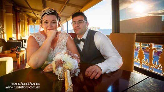 Bride and groom late afternoon light on a balcony, Broken Hill wedding.