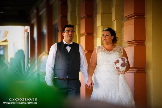Bride and groom walking down the street in Broken Hill. Excitations photographers Mildura.