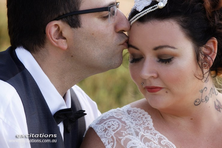 Close up of groom kissing bride at Broken Hill wedding. Wedding photography by Excitations.