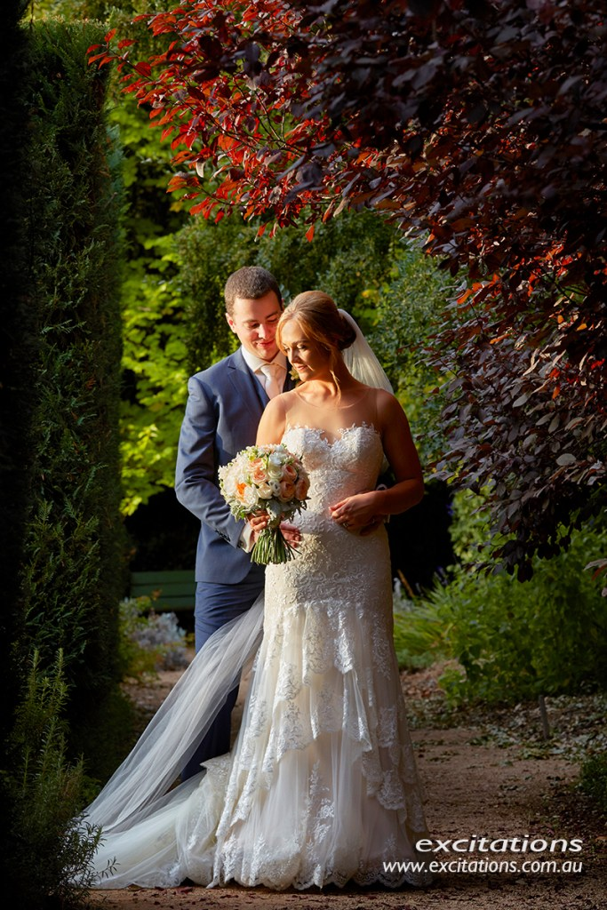 Formal bridal portrait full length amazing late afternoon light in a beautiful garden. Mildura wedding photography by Excitations photographers Mildura.