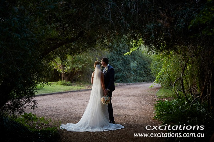 Full length colour wedding mood shot. Photographed in large spacious garden by Excitations Mildura photographers.