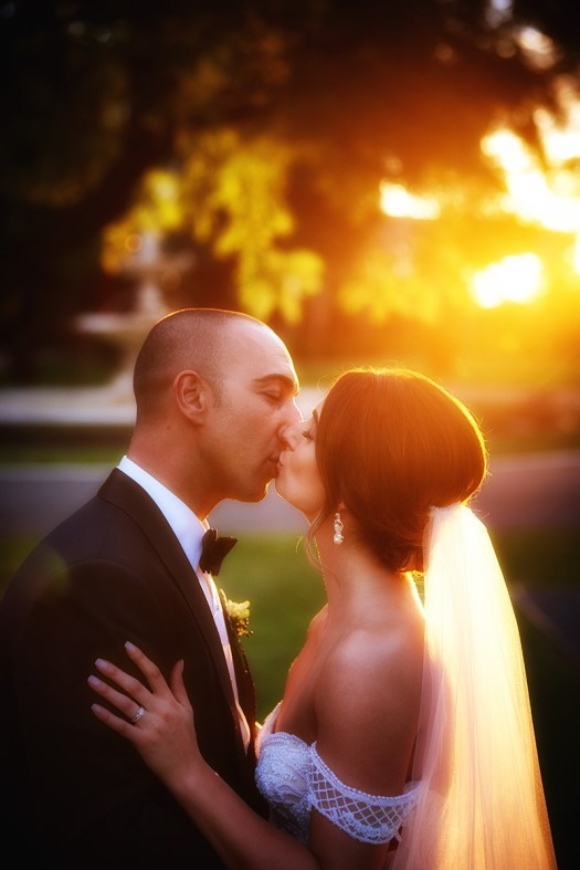 Against the light portrait of bride and groom kissing. Golden tones. Wedding photos in Mildura by excitations.