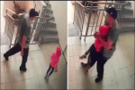 CCTV footage captures the moment a 'paedophile' carried a 7-year-old girl out of her apartment block before assaulting her (video)