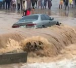 Man stranded in his car after it got stuck in flood following heavy rain in Lagos