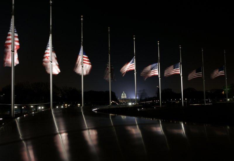 American flags night Washington_1534860546686.jpg