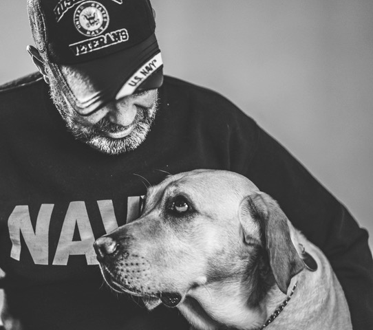 Veteran and Dog _Faces of Veterans_1549657320712.jpeg