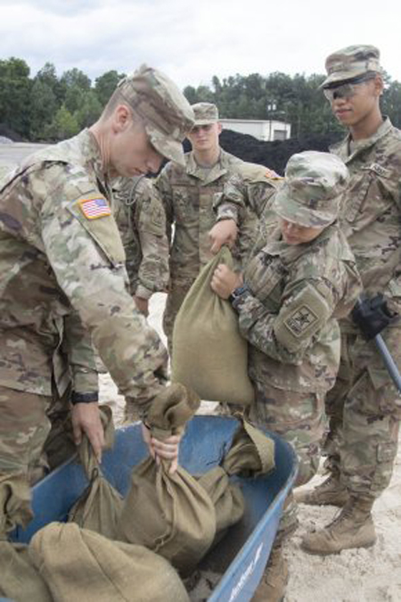 Fort Jackson trainees fill sandbags to help locals stave off any flooding from Hurricane Dorian