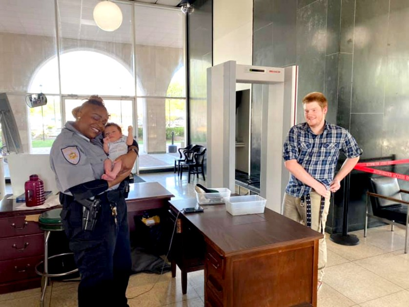 Deputy LaToya Williams takes care of baby for courthouse visitor