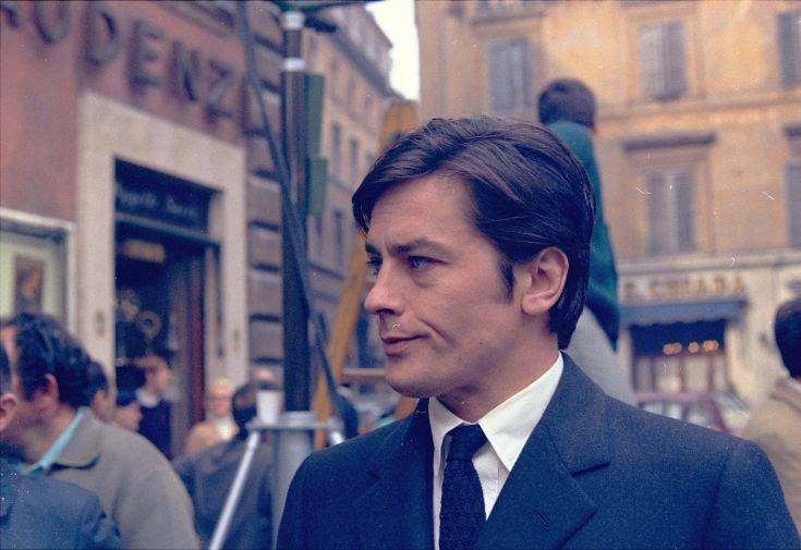 """French actor Alain Delon takes a short walk off the set of a new film, """". Sicilians,"""" during a break in the shooting in the center of Rome March 27, 1969. (AP Photo/Jim Pringle)"""