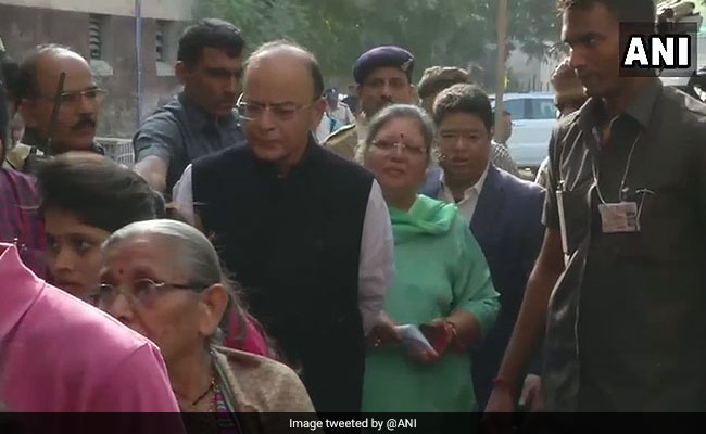 Finance Minister Arun Jaitley stands in a queue at a polling booth in Ahmedabad's Vejalpur