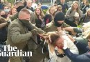 Women tear balaclavas off security officers amid mass arrests in Belarus