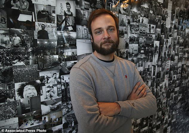 In this Thursday, Oct. 11, 2018, photo Evan Sharp, Pinterest co-founder and chief product officer, poses for a photo in his office beside a wall of pinned photos he has taken at Pinterest headquarters in San Francisco. 'Social media is about sharing what you are doing with other people,' said Sharp. 'Pinterest isn't about sharing. It's mostly about yourself, your dreams, your ideas you want for your future.'