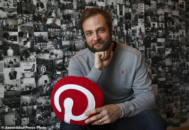 Evan Sharp, Pinterest co-founder and chief product officer, poses for a photo in his office beside a wall of pinned photos he has taken at Pinterest headquarters in San Francisco. 'Social media is about sharing what you are doing with other people,' said Sharp. 'Pinterest isn't about sharing. It's mostly about yourself, your dreams, your ideas you want for your future.'