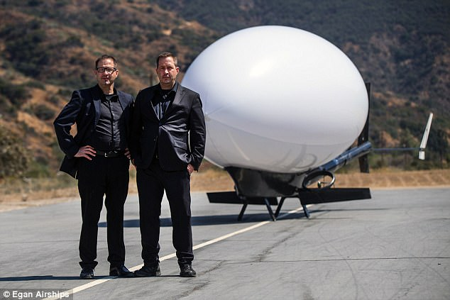 The aircraft, developed by twin brothers James and Joel Egan (pictured), can reach a 500-foot (152-meter) vertical altitude and has a helium-filled blimp to keep it afloat