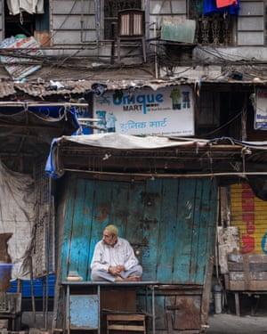 A shopkeeper at a market stall in Bhendi Bazaar