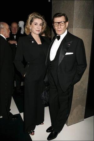 Catherine Deneuve with Yves Saint Laurent in 2005.