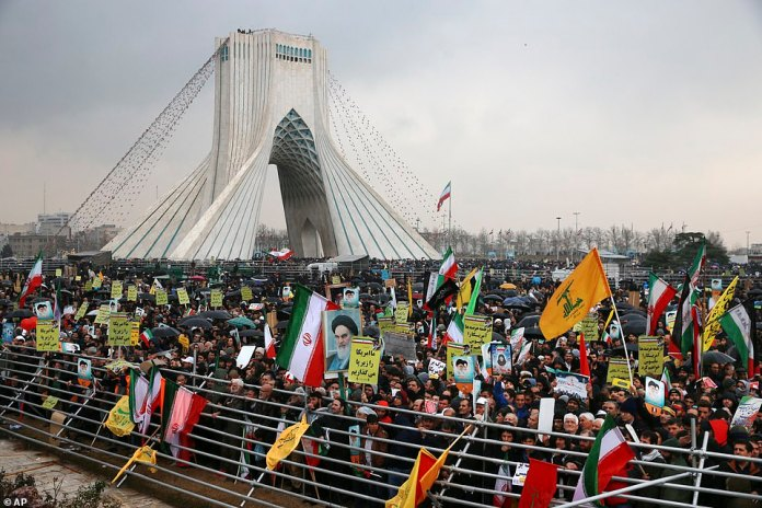 In a speech at Tehran's Azadi Square, President Hassan Rouhani said Iran was determined to expand its military power