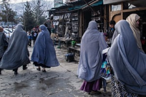 Women stroll through the bazaar in Kabul's old town Murad Khani, where many restaurants, shops, jewellery makers and artists have set up.