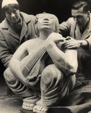 Mary Spencer Watson with one of her pieces, Musician, sculpted in Purbeck stone.
