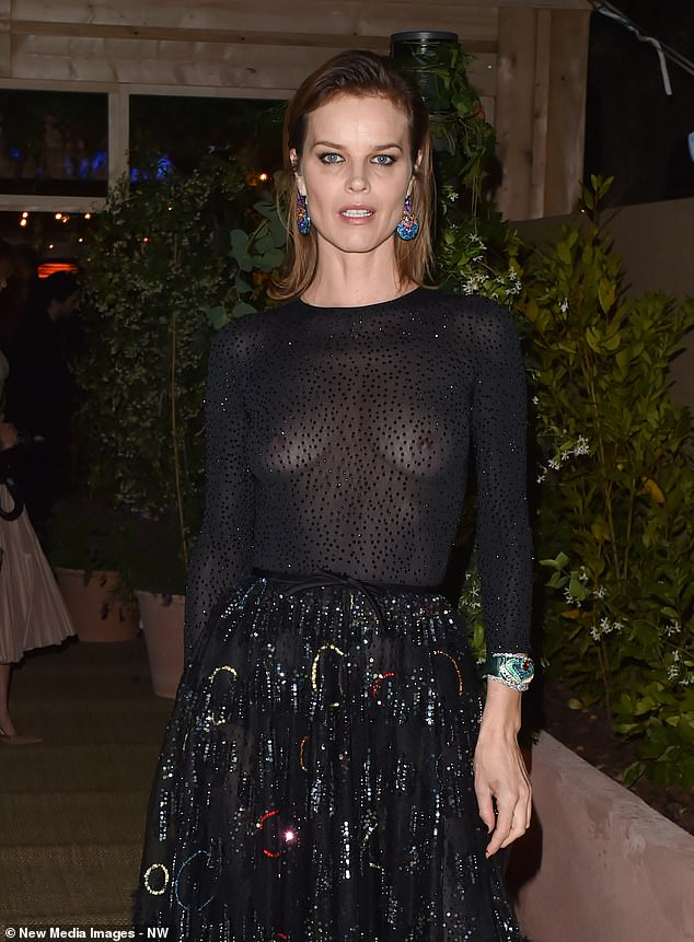 Bold:Fun times: The supermodel confidently flaunted her womanly curves through the long-sleeved sequinned top her dazzling frock as she posed for photographs upon arrival