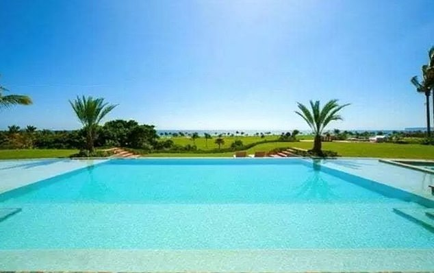 A pool sits outside an $18 million mansion in the Dominican resort town of Punta Cana. The swank property was raided on Sunday by the Caribbean island's narcotics agents and the Drug Enforcement Agency
