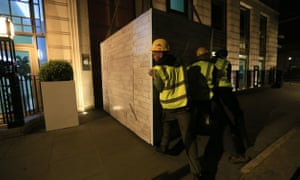 A picture showing Greenpeace activists blocking entrances to BP offices.