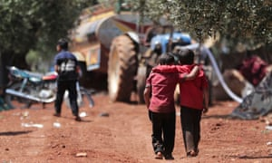Displaced Syrian children in an olive grove in Atmeh, Idlib province.