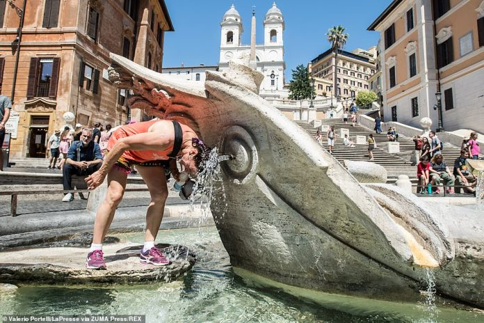 This was the scene in Rome on Tuesday when people were seen cooling themselves off in fountains amid climbing temperatures