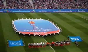 France's and Norway's players ready themselves to belt out their national anthems.