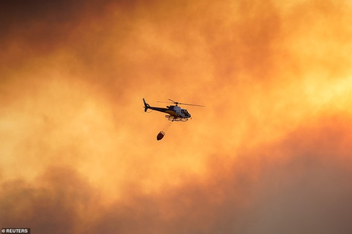 A blaze near the city of Toledo in Spain forced the evacuation of 22 residents, as water-dropping aircraft assisted firefighters on the ground