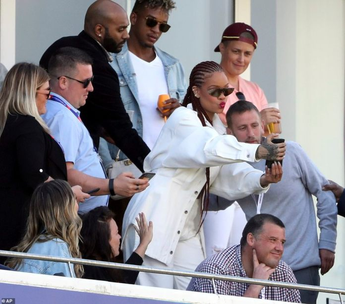 Snapshots: She happily posed for a seemingly endless stream of selfies with excited fans once they spotted her in the stands