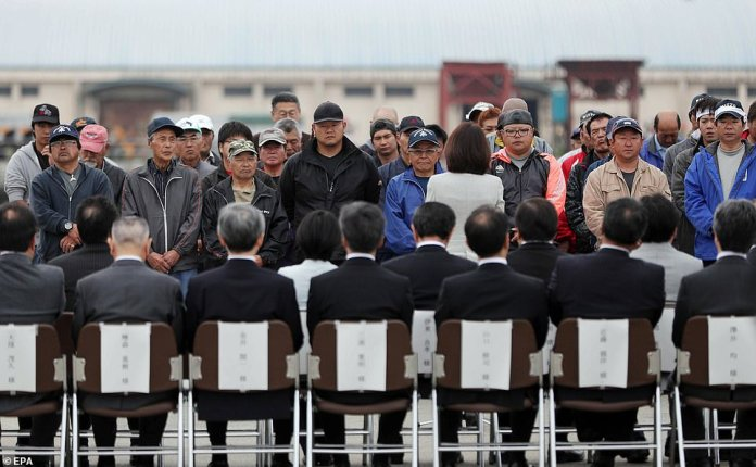Fishermen line up to take part in a ceremony attended by members of the public to bless their trip on Monday morning inKushiro, Hokkaido