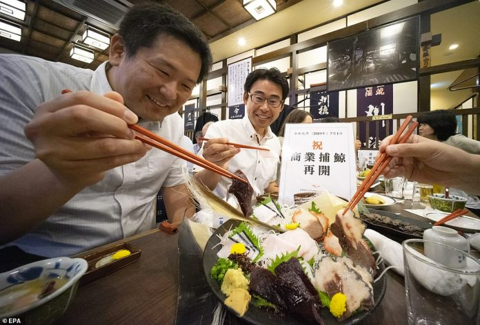 People enjoy eating whale dishes at a restaurant in Tokyo. Whale meat is used in a variety of Japanese dishes