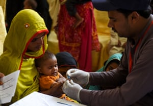 A child is tested for the virus in Rato Dero, Pakistan.