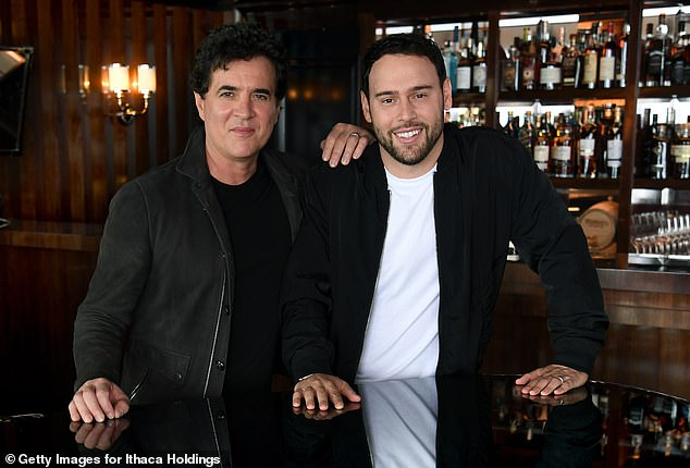 In business:Scott Borchetta and Scooter Braun were snapped last week inin Montecito, California putting the finishing touches on the $300 million deal