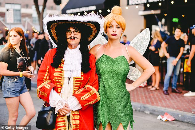 Cosplayers dress as Hook and Tinkerbell from Peter Pan