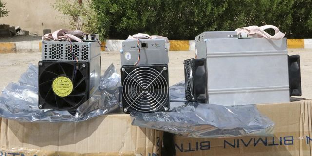 """This undated photo provided by the Police News Agency, shows boxes of machinery used in Bitcoin """"mining"""" operations that were confiscated by police in Nazarabad, Iran. Squeezed by sanctions and fueled by subsidized electricity, Iranians and others lured to the country increasingly are turning to Bitcoin and other digital cryptocurrencies. (News.police.ir via AP)"""