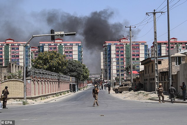 Dozens of people have been injured in a Taliban car bomb attack in Afghanistan. Pictured, Afghan security forces secure the scene this morning