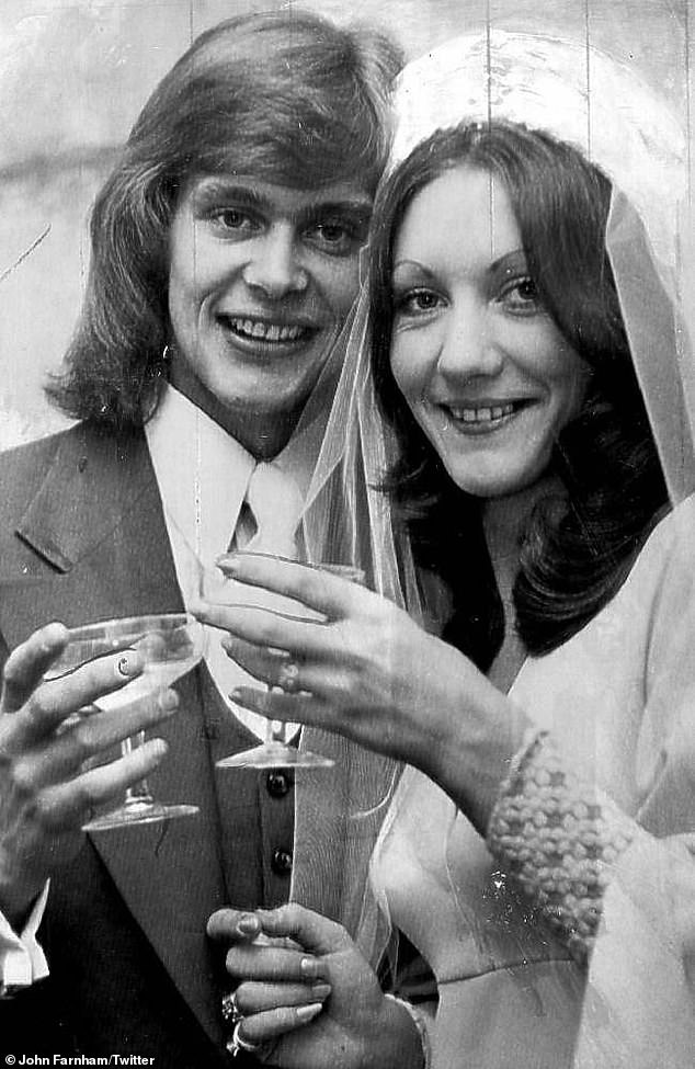 Taking healthy steps! John, pictured with wifeJillian Billman in 1973, said he has since given up his 56-year smoking habit and cut down on alcohol