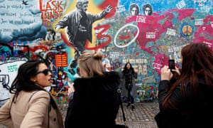 The Lennon Wall, one of Prague's most popular attractions, is covered with graffiti and obscene messsages.