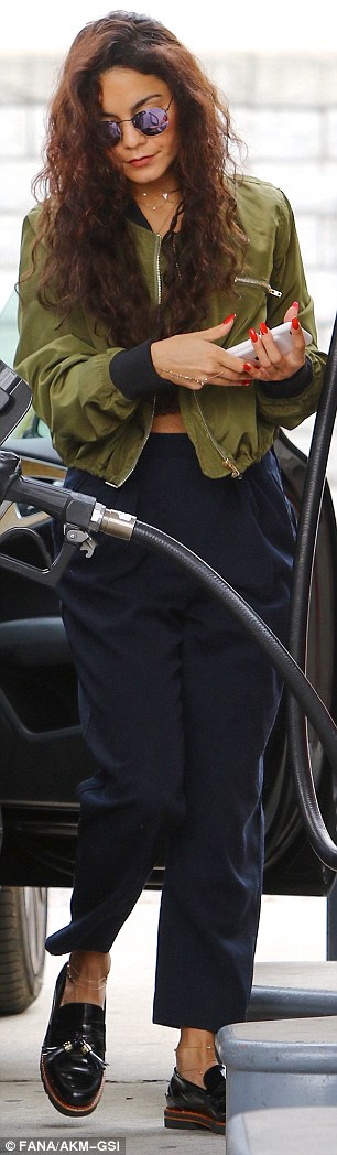Ready Freddy: The starlet held her iPhone in her hand as she finished pumping gas and reentered her car