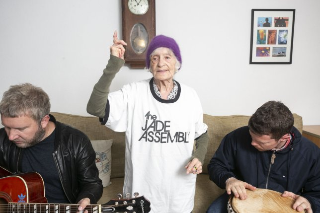 Chrissie Younge (C), the worlds oldest groupie, dances to a song played by her favourite rock band, The Jade Assembly,