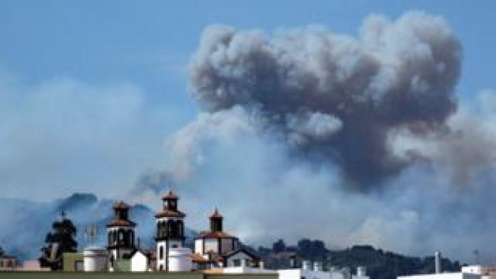 Smoke rises from a forest fire that continues to burn land in Moya, Gran Canaria