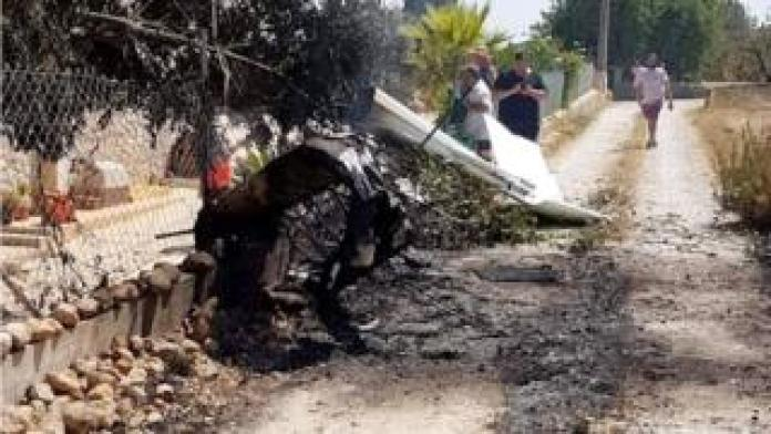 The wreckage of the plane landed in a town's road