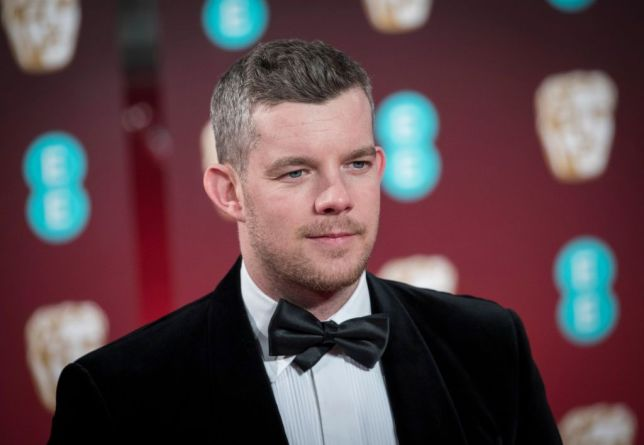 Russell Tovey posing in a tuxedo at the BATFAs