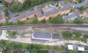 An aerial view of the trackside solar farm .